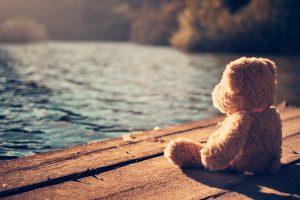 Teddy bear by waterside