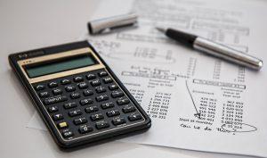 calculator, pen, and data sheet